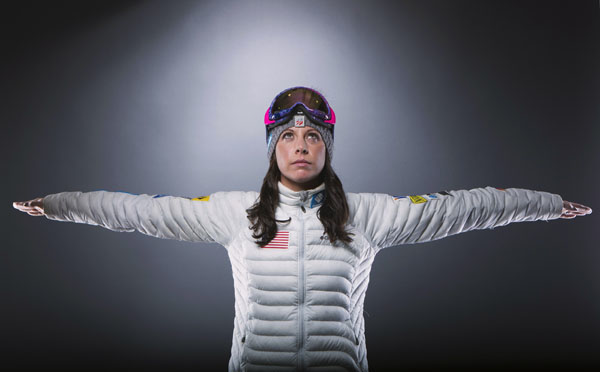 Olympic freestyle skier Emily Cook mimics her pre-visualization preparation before a run, as she poses for a portrait during the 2013 U.S. Olympic Team Media Summit in Park City, Utah