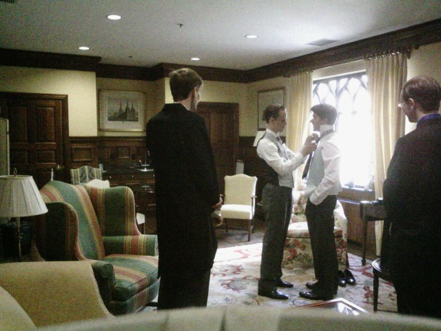Getting ready for the wedding, helping my best man with his tie.