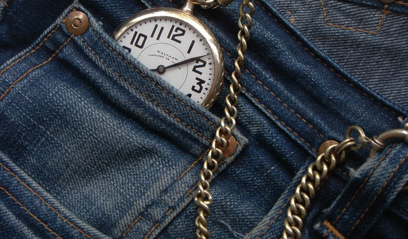 A cowboy's pocket watch in jeans
